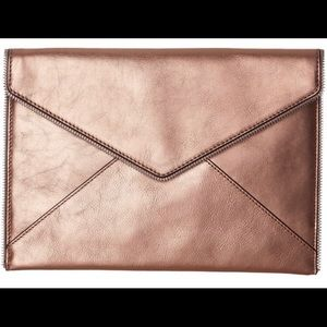 NWT Metallic Rose Gold Leo Clutch